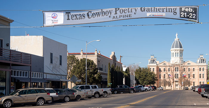 Downtown Marfa banner for Alpine's Texas Cowboy Poetry Gathering.